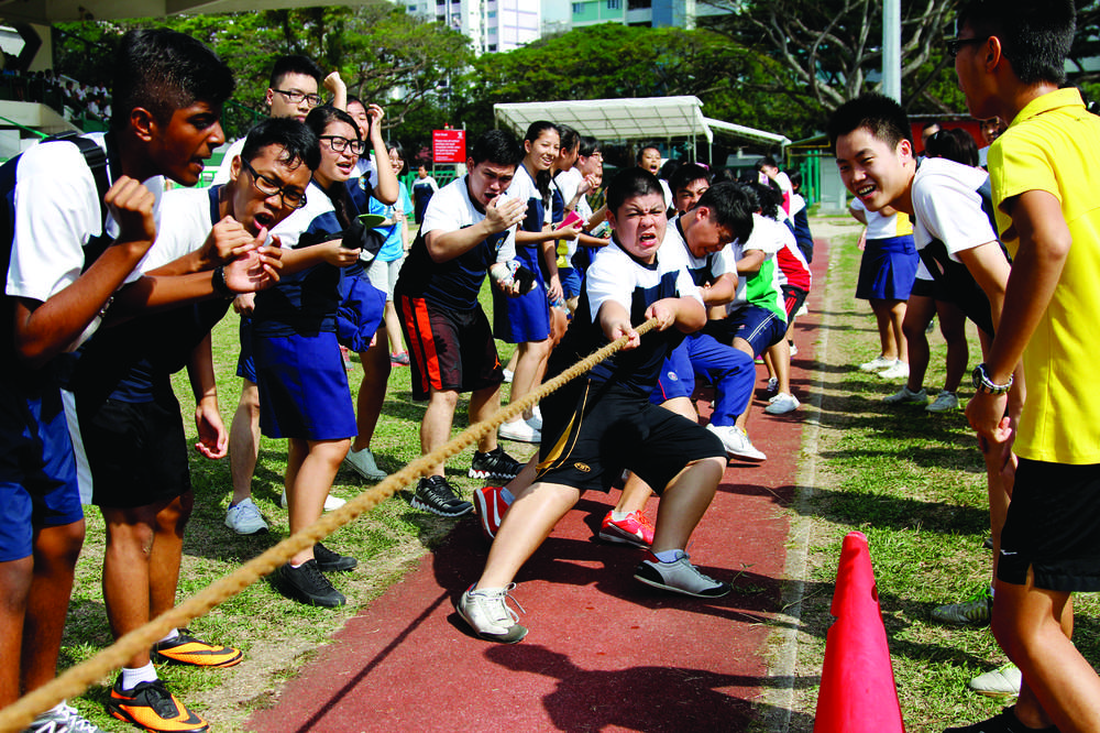 Students pulling together  as one – Singapore's various public institutions, such as  schools, offer Singaporeans the opportunity to come together,understand one another and respect our society's rich diversity.
