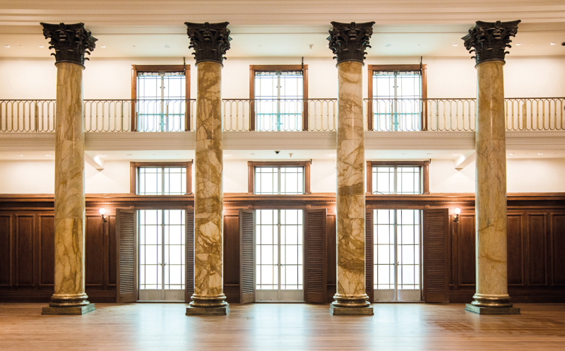 The brass and marble columns and the original lighting fixtures at the City Hall Chamber have been restored.
