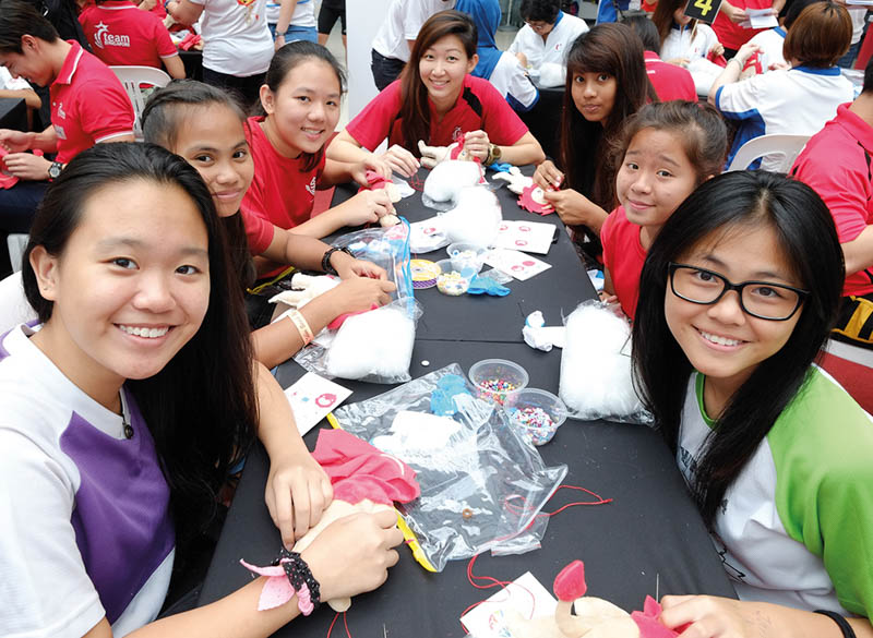 Volunteers, including students and families, helped to sew and stuff thousands of NILA plush toys.