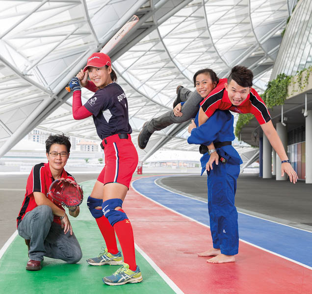 From left to right: Ms Peggy Tng, Ms Cerigwen Ng, and Ms Ang Xuan Yi lifting Mr Ndi Ng in a judo move.