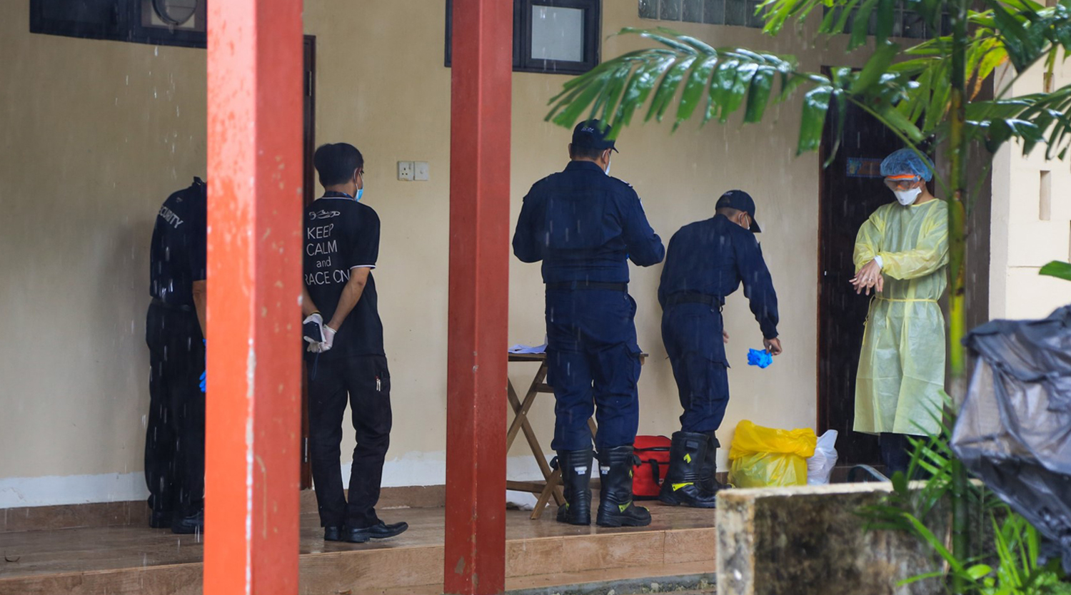 SCDF personnel conducting swabbing operations at a government quarantine facility.