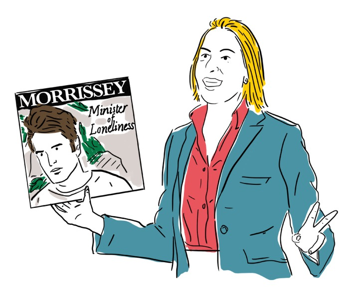 Woman holding a Morrisey record titled Minister of Loneliness