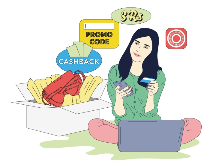 woman holding a credit card in one hand, a smart phone in another, sitting in front of a laptop thinking about buying things online using promo codes, cash backs.