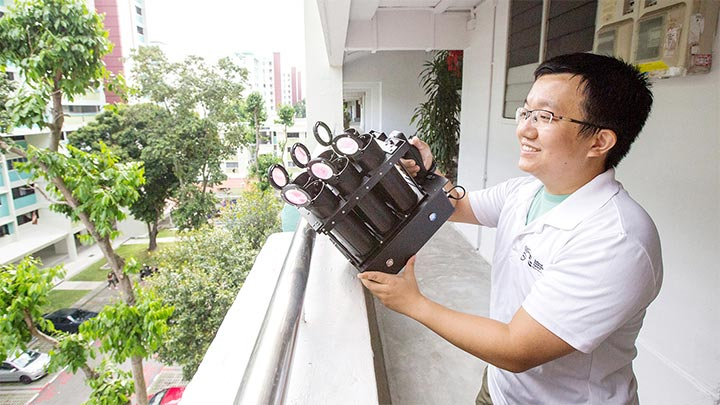 Mr Deng Lu, National Environment Agency (NEA) releasing male Wolbachia-Aedes adult mosquitos using his lightweight mosquito launcher he developed. Article Image