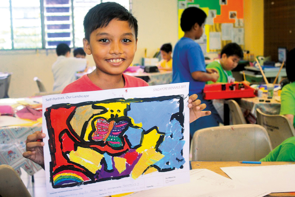 young boy with his artwork